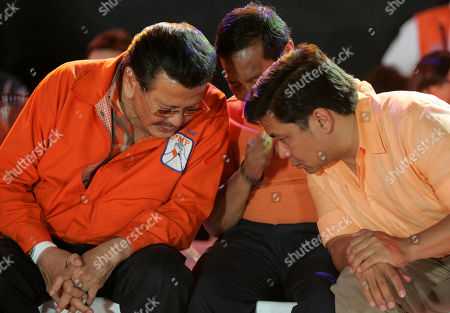 """JOSEPH ESTRADA Ousted Philippine leader and ex-movie action star Joseph Estrada, left, one of nine candidates for the May 10 presidential elections, talks with his son, Senatorial candidate Jose Pimentel """"Jinggoy"""", right, and Vice-Presidential candidate Jejomar Binay, center, during a campaign rally in Makati city, south of Manila, Philippines late . Though some doubted Estrada's chances at the polls when he was overthrown by a nonviolent """"people power"""" revolt and subsequent plunder conviction, he surprised many when he landed second spot in a recent independent popularity survey of the nine candidates"""