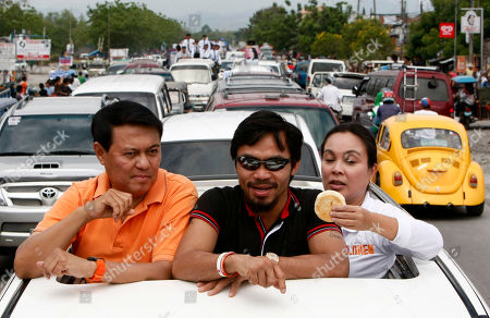 Manny Pacquiao, Manny Villar, Loren Legarda Nationalista Party Vice-Presidential candidate Loren Legarda offers a sandwich to Filipino boxing great Manny Pacquiao, center, as Presidential candidate Manny Villar, left, looks on during a campaign motorcade from General Santos city to Sarangani province in southern Philippines. Pacquiao, who recently won a unanimous WBO welterweight crown against Joshua Clottey of Ghana, is now concentrating on another fight in the political arena as a candidate for congressman in nearby Sarangani province also in southern Philippines