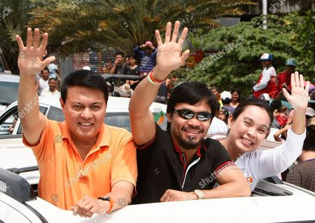 Manny Pacquiao, Manny Villar, Loren Legarda Filipino boxing great Manny Pacquiao, center, Presidential candidate Manny Villar, left, and running mate Loren Legarda wave from their vehicle during a motorcade sortie from General Santos city to Sarangani province in southern Philippines. Pacquiao, who recently won a unanimous WBO welterweight crown against Joshua Clottey of Ghana, is now concentrating on another fight in the political arena as a candidate for congressman in nearby Sarangani province also in southern Philippines