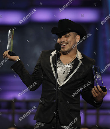 Espinoza Paz Mexico's artist Espinoza Paz holds up his awards for Regional Mexican Airplay Artist of the Year and Songwriter of the Year at the 2010 Billboard Latin Music Awards in San Juan, Puerto Rico