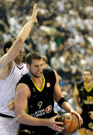 Jared Homan, Aleks Maric BC Maroussi's Jared Homan, centre, challenges for the ball with Aleks Maric of Partizan Belgrade, during their Euroleague Top 16 basketball match, in Belgrade, Serbia