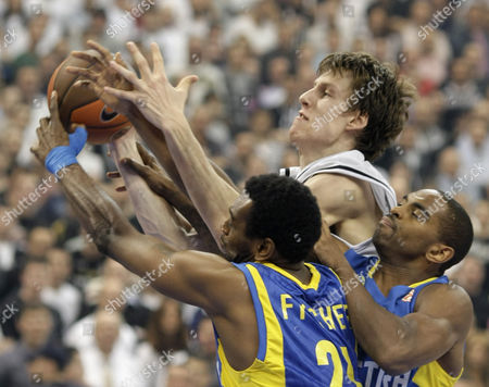 Alan Anderson, D'Or Fischer, Jan Vesely D'Or Fischer, front- left, and Alan Anderson, right, of Maccabi Electra challenges for the ball with Jan Vesely of Partizan Belgrade, during their Euroleague Quarterfinal basketball match, in Belgrade, Serbia