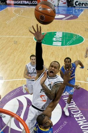 Alan Anderson Alan Anderson of Maccabi Electra, down, challenges for the ball with Lawrence Roberts of Partizan Belgrade, center, during their Euroleague Quarterfinal basketball match, in Belgrade, Serbia