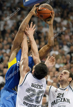 Alan Anderson, Petar Bozic, Aleks Maric Alan Anderson of Maccabi Electra, with ball, in action with Petar Bozic and Aleks Maric of Partizan Belgrade, during their Euroleague Quarterfinal basketball match, in Belgrade, Serbia