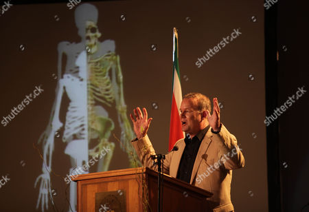 Lee Berger Professor Lee Berger, of the University of the Witwatersrand, in front of projected images, at the reveal of one of two nearly 2 million-year-old skeletons unearthed in South Africa, at Maropeng, near Johannesburg, . The fossils are part of a previously unknown species that scientists say fits the transition from ancient apes to modern humans