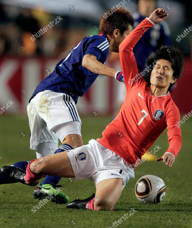 Kim Jee-sung, Junichi Inamoto South Korea's midfielder Kim Jee-sung (7) is pushed by Japan's midfielder Junichi Inamoto in their East Asian Championships soccer match at the National Stadium in Tokyo, Japan, . South Korea won 3-1