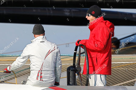 Ernesto Bertarelli Alinghi's owner Ernesto Bertarelli, right, steers the Alinghi 5 as they wait for the start of race 2 of the 33rd America's Cup against American BMW Oracle BOR 90 in Valencia, Spain, on