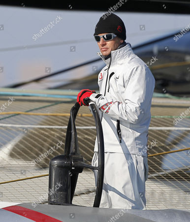 Ernesto Bertarelli Alinghi's owner Ernesto Bertarelli steers the Alinghi 5 as they wait for the start of race 2 of the 33rd America's Cup against American BMW Oracle BOR 90 in Valencia, Spain, on