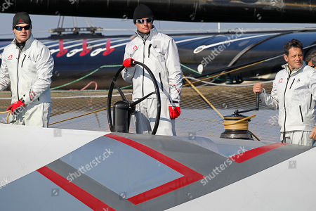 Ernesto Bertarelli Alinghi's owner Ernesto Bertarelli, center, steers the Alinghi 5 as they wait for the start of race 2 of the 33rd America's Cup against American BMW Oracle BOR 90 in Valencia, Spain, on