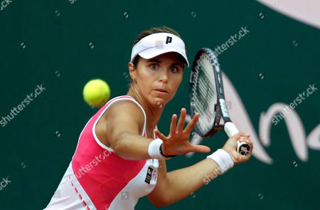 Maria Jose Martinez Maria Jose Martinez of Spain returns the ball to Carla Suarez of Spain during their semi final match at the Andalucia Tennis Experience tournament in Marbella, southern Spain