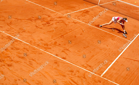 Maria Jose Martinez Maria Jose Martinez of Spain misses the ball in her match against Carla Suarez of Spain during their semi final match at the Andalucia Tennis Experience tournament in Marbella, southern Spain, on