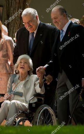 Juan Carlos, Ana Maria Matute Spanish writer Ana Maria Matute, bottom, holds the hand of Spanish King Juan Carlos after the Cervantes literary prize ceremony in Alcala de Henares, Spain, on . Other is unidentified