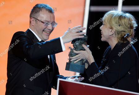 "Daniel Monzon, Rosa Maria Sarda Daniel Monzon,of Spain, left, receives the Best Director award for ""Celda 211"" (Cell 211) from Spanish actress Rosa Maria Sarda during the Goya 2010 film awards in Madrid"
