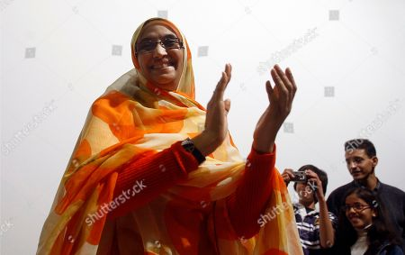 AMINATOU HAIDAR Western Sahara independence campaigner Aminatou Haidar applauds during a conference in Granada, Spain while an EU - Morocco summit was taking place in town