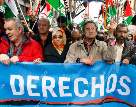 AMINATOU HAIDAR Western Sahara independence campaigner Aminatou Haidar, center left, flanked by United Left party member Cayo Lara, left and Willy Meyer march during a protest against Morocco in Granada, Spain as a EU - Morocco summit was taking place across town. Haidar, launched a hunger strike last October as a political ploy to rachet up tensions over the disputed Western Saharan territory. Morocco has ruled the territory for decades, fending off Polisario guerrillas fighting for independence. Banner reads ; Rights