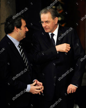 Jacques Rogge, right, President of the International Olympic Committee (IOC), talks with Jordi Hereu, Barcelona's major, during the farewell ceremony for the International Olympic Committee president Juan Antonio Samaranch at the Palau of Generalitat in Barcelona, Spain, on . Former International Olympic Committee president Juan Antonio Samaranch died Wednesday at age 89 in the Quiron Hospital in his home city of Barcelona of cardio-respiratory failure three days after being admitted with heart problems