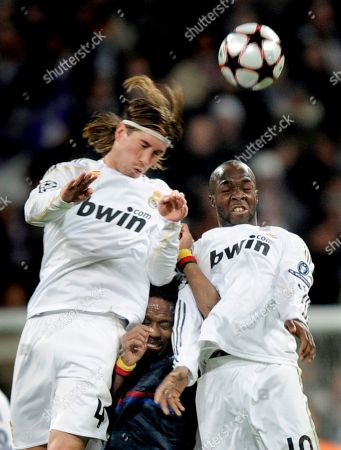 Sergio Ramos, Jean II Makoun, Lassana Diarra Real Madrid's Sergio Ramos from Spain, left, heads for the ball against Lyon's Jean II Makoun of Cameroon, center, and Lassana Diarra from France during the second leg of the first knockout round Champions League soccer match at the Santiago Bernabeu stadium in Madrid