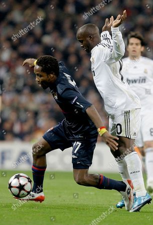 Jean II Makoun, Lassana Diarra Lyon's Jean II Makoun of Cameroon, left gets past Real Madrid's Lassana Diarra from France during the second leg of the first knockout round Champions League soccer match at the Santiago Bernabeu stadium in Madrid
