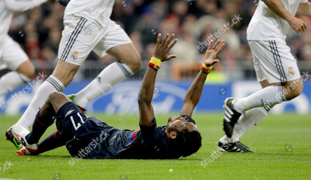 Jean II Makoun Lyon's Jean II Makoun of Cameroon reacts during the second leg of the first knockout round Champions League soccer match against Real Madrid at the Santiago Bernabeu stadium in Madrid