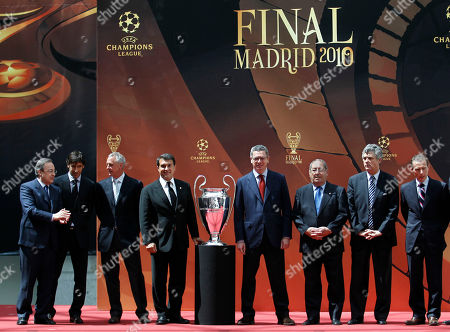 Stock Photo of Florentino Perez, Raul Gonzalez, Johan Cruyff, Joan Laporta, Alberto Ruiz-Gallardon, Francisco Gento, Emilio Butragueno Group photo with the Champions League trophy, center, during the handover ceremony in Madrid on . From left: Real Madrid president Florentino Perez, Real Madrid player Raul Gonzalez, Barcelona FC honorary president Johan Cruyff, Barcelona's FC president Joan Laporta, Madrid's Mayor Alberto Ruiz-Gallardon, former Real Madrid player Francisco Gento and former Real Madrid player and current director of institutional relations Emilio Butragueno. Madrid will host the Champions League final on May 22