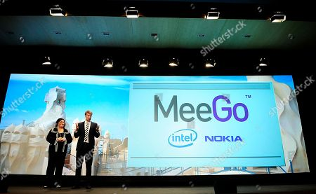 """Stock Photo of Kai Oistamo, Renee James Nokia Executive Vice President Devices Kai Oistamo, right, and Senior Vice President and General Manager of the Software and Services Group for Intel Corporation Renee James during the """"MeeGo"""" presentation the latest pretender in the increasingly congested operating system (OS) market at the Mobile World congress in Barcelona, Spain, . MeeGo is an open-source, Linux-based platform - just like Google's Android - combining the best of Nokia's Maemo and Intel's Moblin systems. It was unveiled at a press event on the first day of Mobile World Congress in Barcelona, the world's largest mobile phone trade show. The partnership between the world's largest computer chip maker and the world's largest mobile phone maker signals a direct challenge to rival OS systems from Microsoft, Google and Apple. The Mobile World Congress will be held from Feb. 15-18"""