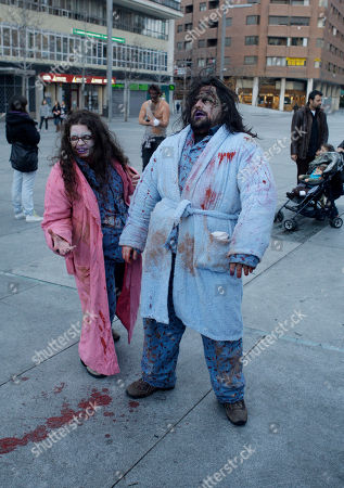 People dressed and made up as Zombies, seen, during the annual Zombie march in Madrid, . The zombie march is a homage to the Zombie film genre and to U.S. director George A. Romero, famous for his Zombie horror movies
