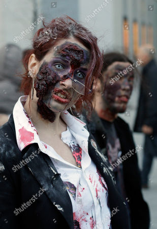 A winab dressed and made up as a zombie participates in the annual Zombie march in Madrid, . The zombie march is a homage to the Zombie film genre and to U.S. director George A. Romero, famous for his Zombie horror movies