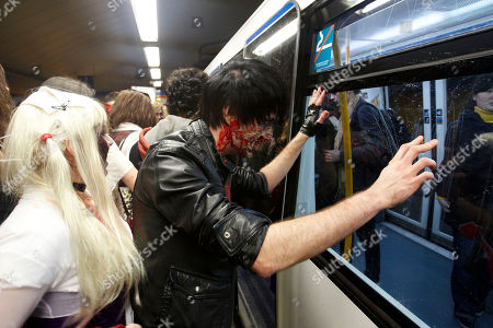 People dressed and made up as Zombies try to board a metro train during the annual Zombie march in Madrid, . The zombie march is in homage by fans to the Zombie film genre and to U.S. director George A. Romero, famous for his Zombie horror movies