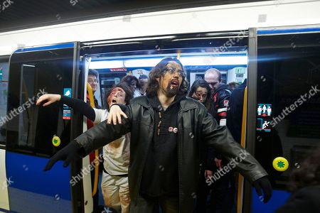 People dressed and made up as Zombies get off a metro train during the annual Zombie march in Madrid, . The zombie march is in homage by fans to the Zombie film genre and to U.S. director George A. Romero, famous for his Zombie horror movies