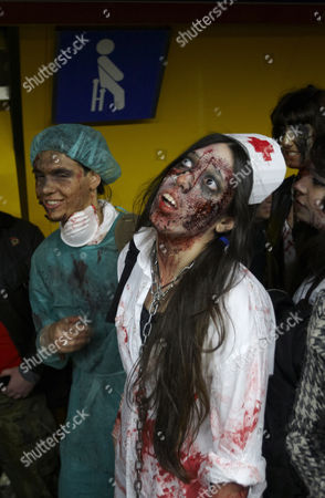 People dressed and made up as Zombies wait on the platform for a metro train during the annual Zombie march in Madrid, . The zombie march is in homage by fans to the Zombie film genre and to U.S. director George A. Romero, famous for his Zombie horror movies