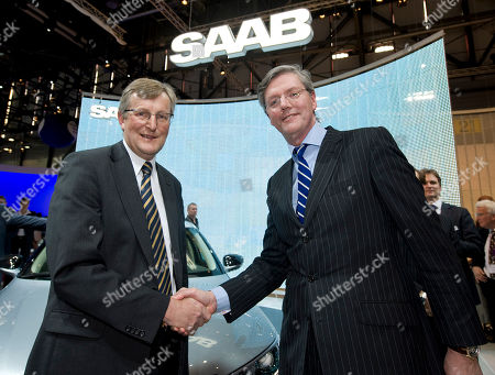 Stock Photo of Jan-Ake Jonsson, Victor Muller Saab CEO Jan-Ake Jonsson, left, and investor Spyker CEO Victor Muller, right, shake hands after declaring the rescue of Swedish carmaker Saab at the Geneva Motor Show in Geneva, Switzerland, . About 250 exhibitors from 30 countries, showing 100 car premieres at the Auto Show until March 14