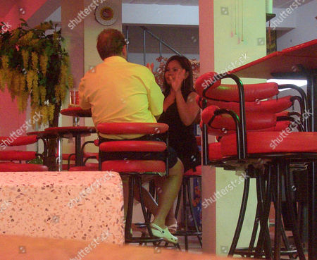 Johnny Briggs talking to prostitute 'Yo' in the Lucky Bar, Pattaya Thailand. Yo putting up 10 fingers, indicating her price, 1,000 Baht, 15 pounds, per night.