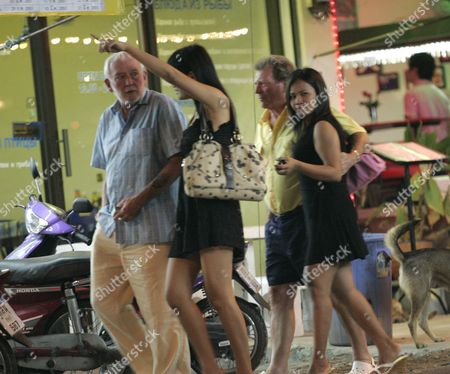 Johnny Briggs walking back to the Dynasty Hotel, Pattaya,  with his friend and two prostitutes.