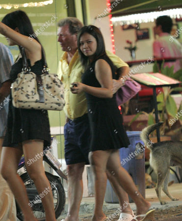 Former Coronation St star Johnny Briggs walking back to the Dynasty Hotel, Pattaya, with his friend and two prostitutes.