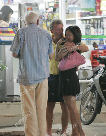 Johnny Briggs wit prostitute 'Yo' while walking back to the Dynasty Hotel, Pattaya, with his friend after 'buying' her from the nearby Lucky Bar.