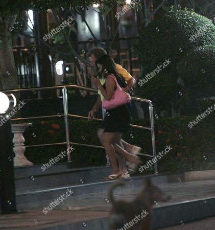 Johnny Briggs walking back into the Dynasty Hotel, Pattaya,  with his friend and two prostitutes.