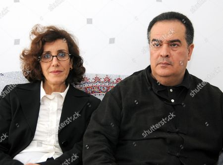 Stock Picture of Taoufik Ben Brik, Azza Zarad Prominent Tunisian journalist, Taoufik Ben Brik, poses with his wife, Azza Zarad, in their apartment in Tunis, Tunisia, . Taoufik Ben Brik who had criticized his government was freed Tuesday after serving a six-month prison sentence. Taoufik Ben Brik, who had written stories critical of President Zine El Abidine Ben Ali for French media, was convicted last year on assault charges that his lawyer and media watchdog Reporters Without Borders say were trumped up