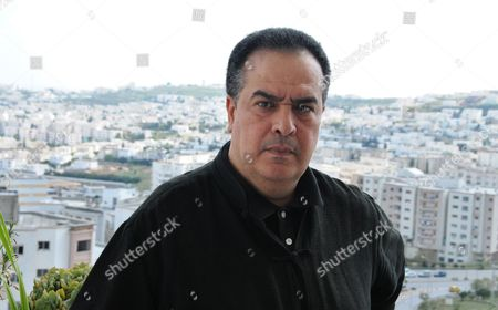 Taoufik Ben Brik Prominent Tunisian journalist, Taoufik Ben Brik, poses in his apartment overlooking the Tunisian capital, Tunis, . Taoufik Ben Brik who had criticized his government was freed Tuesday after serving a six-month prison sentence. Taoufik Ben Brik, who had written stories critical of President Zine El Abidine Ben Ali for French media, was convicted last year on assault charges that his lawyer and media watchdog Reporters Without Borders say were trumped up