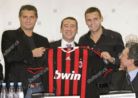 Italian chairman of Supervisory of Pravex-Bank Silvio Pedrazzi, center, A.C. Milan former player and now P.R. manager for the club, Daniele Massaro, left, Dynamo Kiev's forward Andrey Shevchenko, center right, and ambassador of Italy in Ukraine Pietro Giovanni Donnici, as they hold onto an A.C Milan shirt as they announce the opening of the first Milan Junior Camp for Ukraine in Kiev, Ukraine, . Milan Junior Camps are a one-week-long soccer camp aimed at young players from 8-16 years old