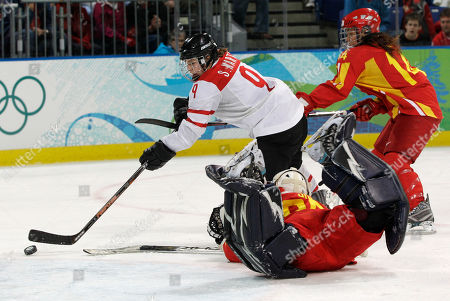 Switzerland's forward Stefanie Marty (9) scores her fourth goal of the game past China's goalie Jia Dandan in a women's classifications hockey game at the Vancouver 2010 Olympics in Vancouver, British Columbia, . Switzerland won 6-0. China's forward Sun Rui is at right