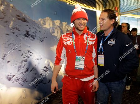 Washington Capitals and Team Russia player Alexander Ovechkin, left, walks with former NHL player Jeremy Roenick during the Vancouver 2010 Olympics in Vancouver, British Columbia
