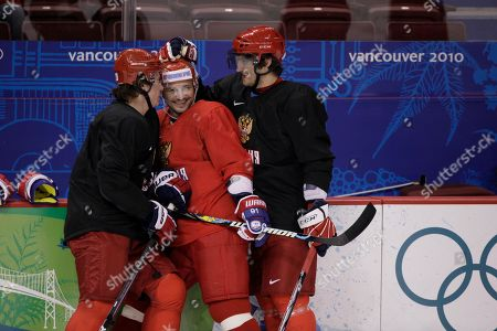 Russia's Alexander Ovechkin, right, and Sergei Fedorov, center, are shown during men's ice hockey practice at the Vancouver 2010 Olympics in Vancouver, British Columbia