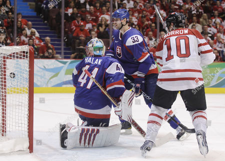 Canada's Brenden Morrow (10) watches a shot by teammate Ryan Getzlaf, not visible, go into the net for a goal against Slovakia's goalie Jaroslav Halak (41) in the second period of a men's semifinal round ice hockey game at the Vancouver 2010 Olympics in Vancouver, British Columbia, . Also defending is Zdeno Chara (33