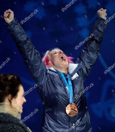 Women's moguls bronze medalist Shannon Bahrke of the USA celebrates during the medal ceremony at the Vancouver 2010 Olympics in Vancouver, British Columbia