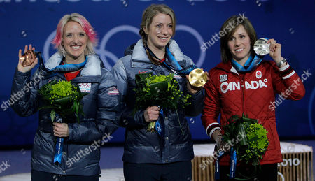 Gold medalist in women's moguls Hannah Kearney of the USA, center, silver medalist Jennifer Heil of Canada, right, and bronze medalist Shannon Bahrke of the USA during the medal ceremony at the Vancouver 2010 Olympics in Vancouver, British Columbia