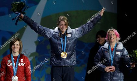 Gold medalist in women's moguls Hannah Kearney of the USA, center, silver medalist Jennifer Heil of Canada, left, and bronze medalist Shannon Bahrke of the USA celebrate during the medal ceremony at the Vancouver 2010 Olympics in Vancouver, British Columbia