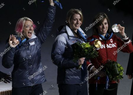 Gold medalist in women's moguls Hannah Kearney of the USA, center, silver medalist Jennifer Heil of Canada, right, and bronze medalist Shannon Bahrke of the USA celebrate during the medal ceremony at the Vancouver 2010 Olympics in Vancouver, British Columbia