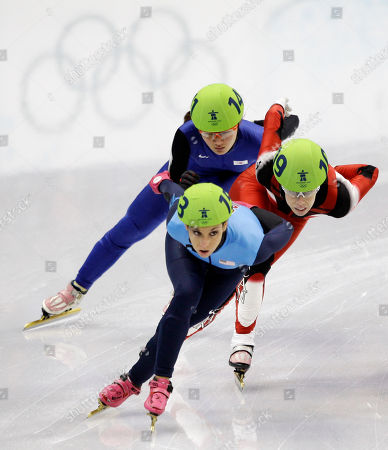 USA's Allison Baver, front, leads Canada's Tania Vicent, center, and South Korea's Park Seung-Hi, back, during the first heat of the women's 1000m short track skating competition at the Vancouver 2010 Olympics in Vancouver, British Columbia