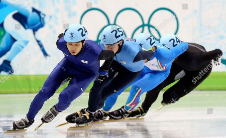 Stock Image of South Korea's Sung Si-Bak, left, USA's J.R. Celski, second from left, Italy's Yuri Confortola, second from right, and New Zealand's Blake Skjellerup, right, compete during the third race of the men's 1000m quarterfinals short track skating competition at the Vancouver 2010 Olympics in Vancouver, British Columbia
