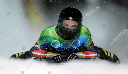 Michi Halilovic of Germany brakes in the finish area during the final run of the men's skeleton competition at the Vancouver 2010 Olympics in Whistler, British Columbia